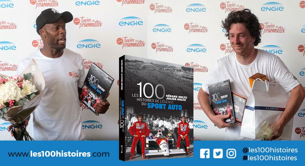 Les 100 Histoires de Légende du Sport Auto entre les mains de Sylvain Wiltord (à gauche) et Jean Imbert (à droite)